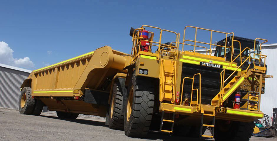 CAT scrapper.This is either a Caterpillar 776 or a 784