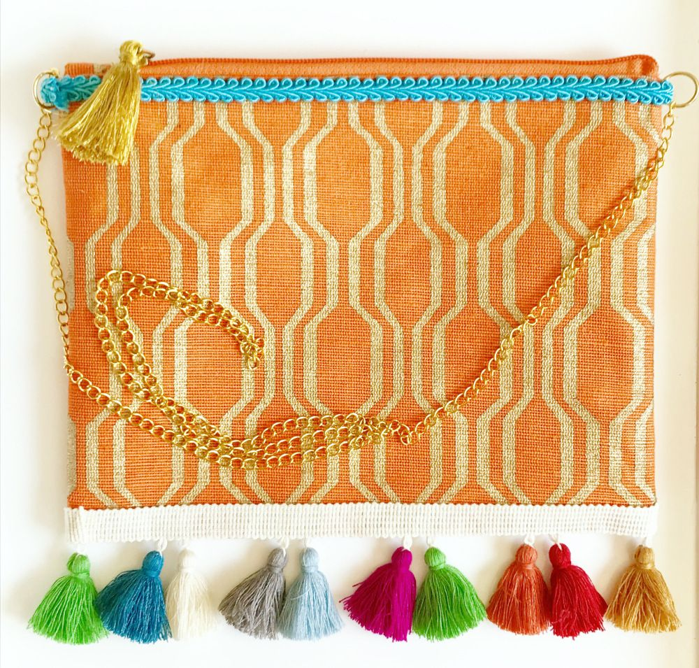 Super cute tassel clutch or cross body bag!