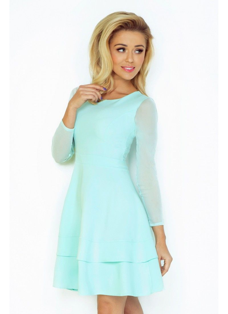 Krásne šaty v trendy mätovej farbe s dlhými rukávmi z jemného materiálu. Štýl značky NUMOCO