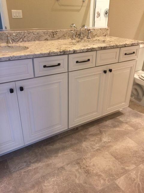 White Springs Granite Slab On Sierra Ridge Linen Cabinets