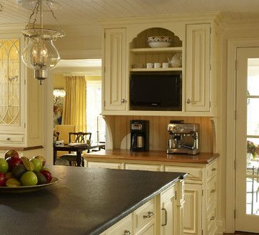 Kitchen With Dark Cream Pale Yellow Cabinets Soapstone Counters