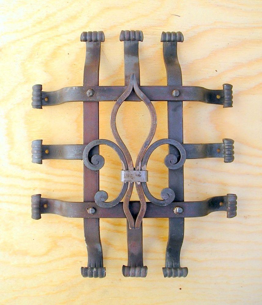 Fleur de lis wrought iron speakeasy door grille | Wrought iron, Iron ...