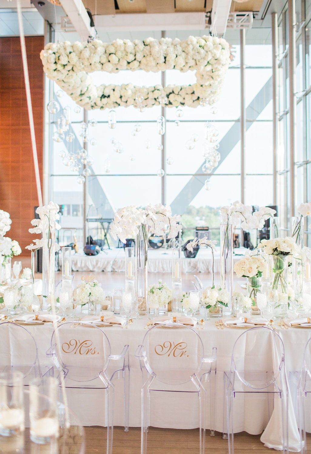 Gorgeous modern formal seated wedding dinner in all white with gold ...