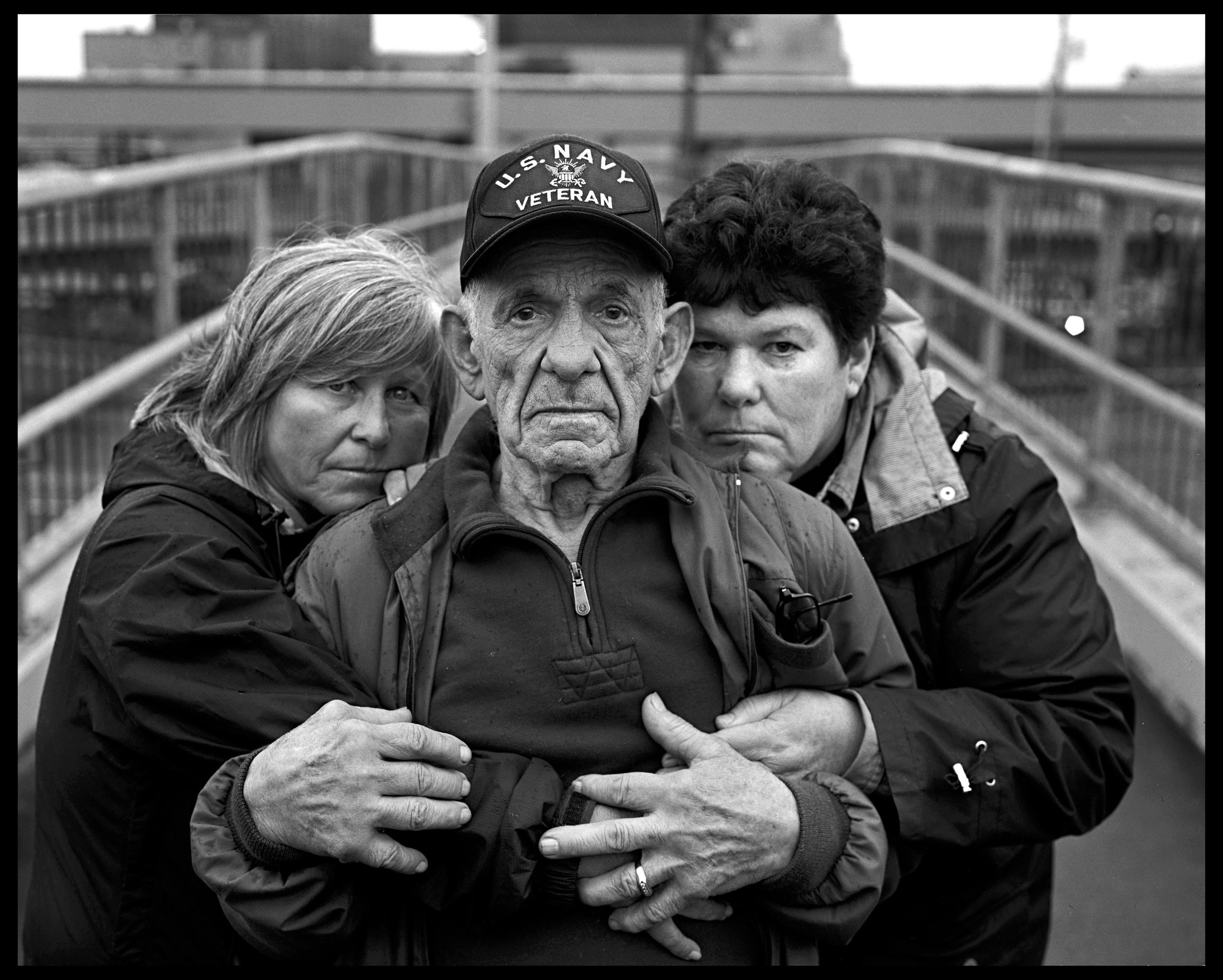 Vince Mardesich, who worked at Scott Paper Co. for 32 years starting in 1954, with his daughters, Angie Mardesich (left), who worked at the mill for 16 years, until December, and Joanne Moore, who has worked at the mill for 38 years. In the past several years, Moore has driven a forklift, a job she absolutely loves. It's the same job her father did. The closure of the paper mill, now run by Kimberly-Clark, marks the end of an era in Everett. (Photo by Mark and Annie Mulligan, The Herald)