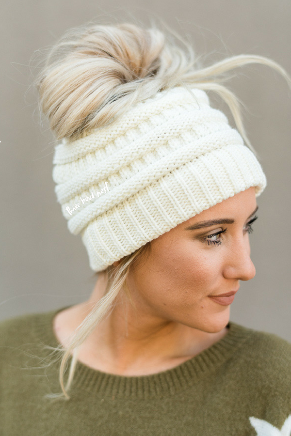 53b93507fbc You can now wear a messy bun or ponytail and a beanie all at the same time  with our amazing Messy Bun Knitted Beanie Hat.