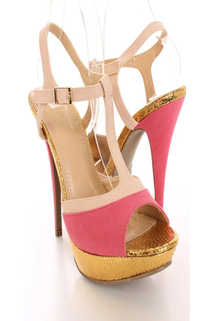 Look fabulous for your girls night out in these cute heels! You can dress them up with a sexy mini dress or dress them down for a more casual look with your favorite skinnies! The simple yet stylish design is sure to make these heels your most favorite this season! Featuring t-strap, color block, peep toe, reptile platform, faux suede, smooth lining, and cushioned footbed. Approximately 5 1/2 inch heel and 1 1/2 inch platform.