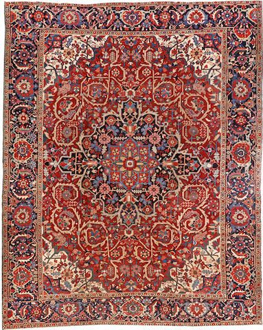 Heriz carpet  Northwest Persia  circa 1920  size approximately 9ft. 4in. x 11ft. 9in.