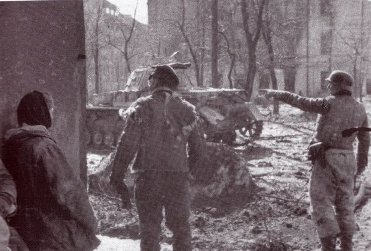 SS-Hauptsturmfuhrer Rudolf Von Ribbentrop and SS-Uscha Paul Klose downtown Kharkov, 1943