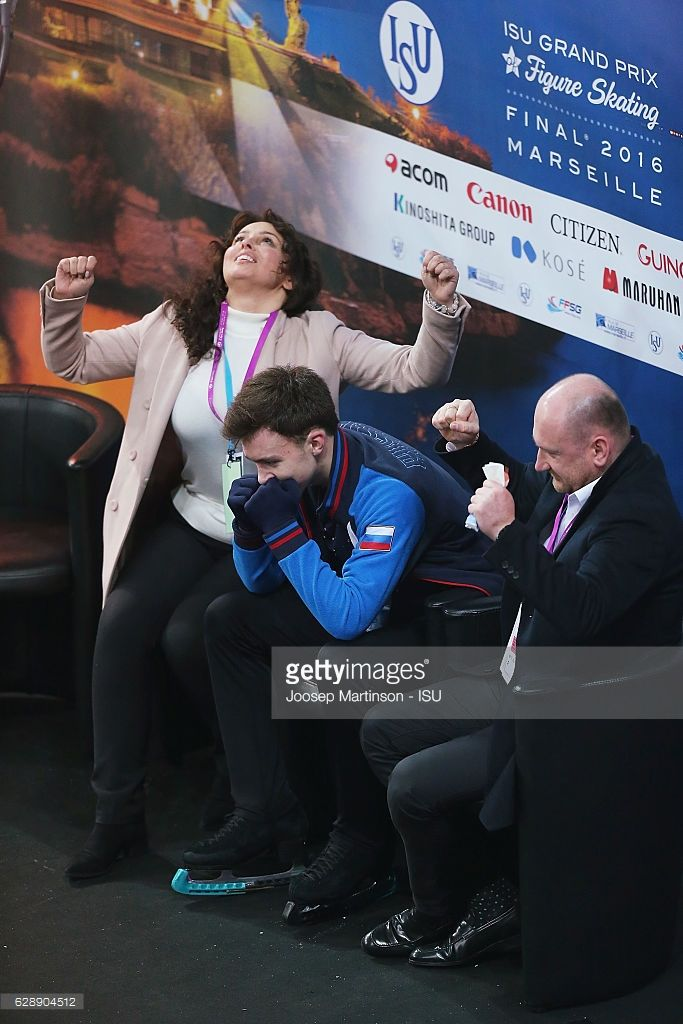 News Photo : Dmitri Aliev of Russia reacts after winning...