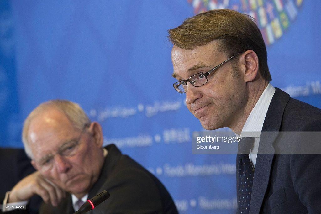 Jens Weidmann, president of the Deutsche Bundesbank, right