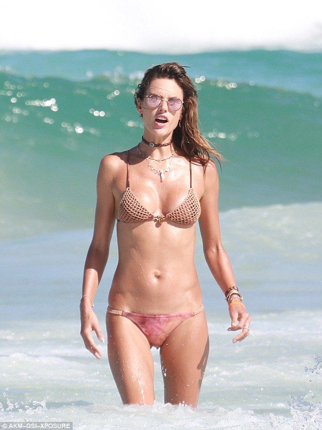 4dcf05ba9b Stylish swimwear: The 35-year-old Victoria's Secret model teamed pink  tie-dye bottoms with a crochet top