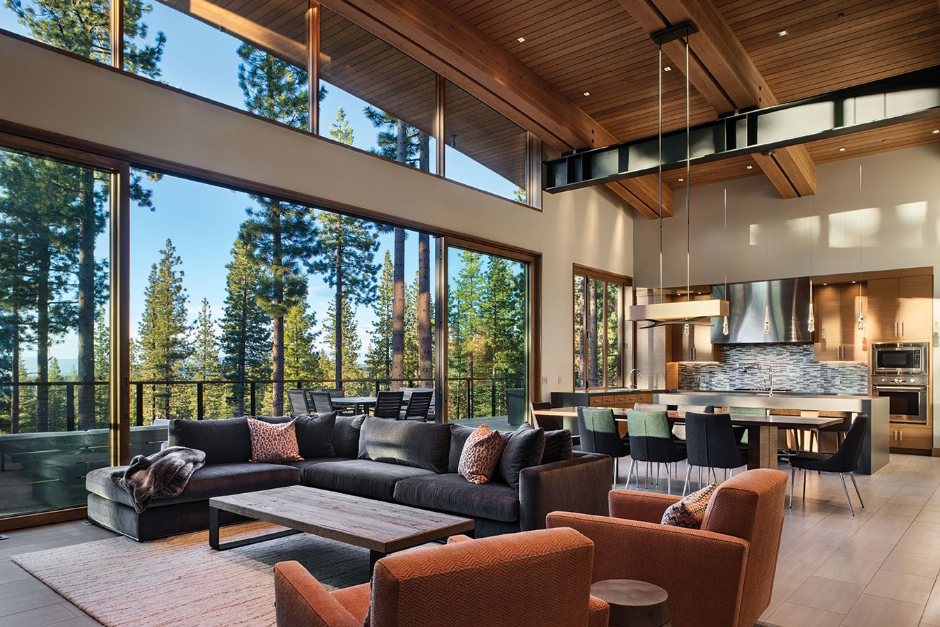 Martis camp home blends in yet stands out with a simple arc and