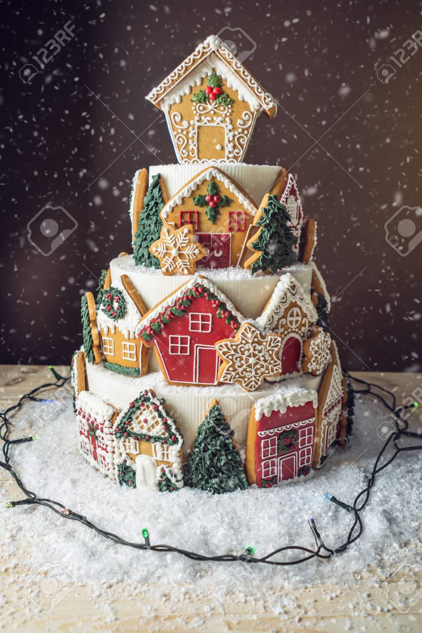 Photo of Large tiered Christmas cake decorated with gingerbread cookies