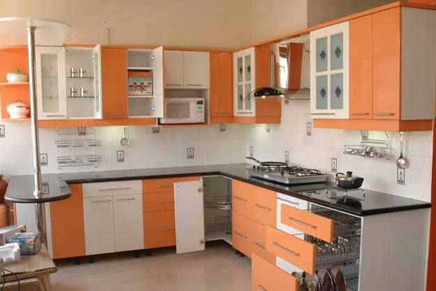 Large Kitchen With Orange Display Windows