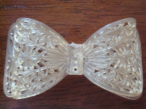 Vintage lucite acrylic plastic bow broach pin filigre