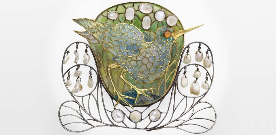 enamel marsh-bird decorated with moonstones and pearls was created by English Arts and Crafts designer Charles Robert Ashbee as a hair ornament that was later converted to a brooch http://www.mfa.org/sites/default/files/images/2007.827.crop_.jpg