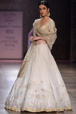 880ea13d2d Rimple and Harpreet Narula indian designer runway couture 2016 collection  online. an ivory tulle lehenga with gold and white tonal resham and kasab  work in ...