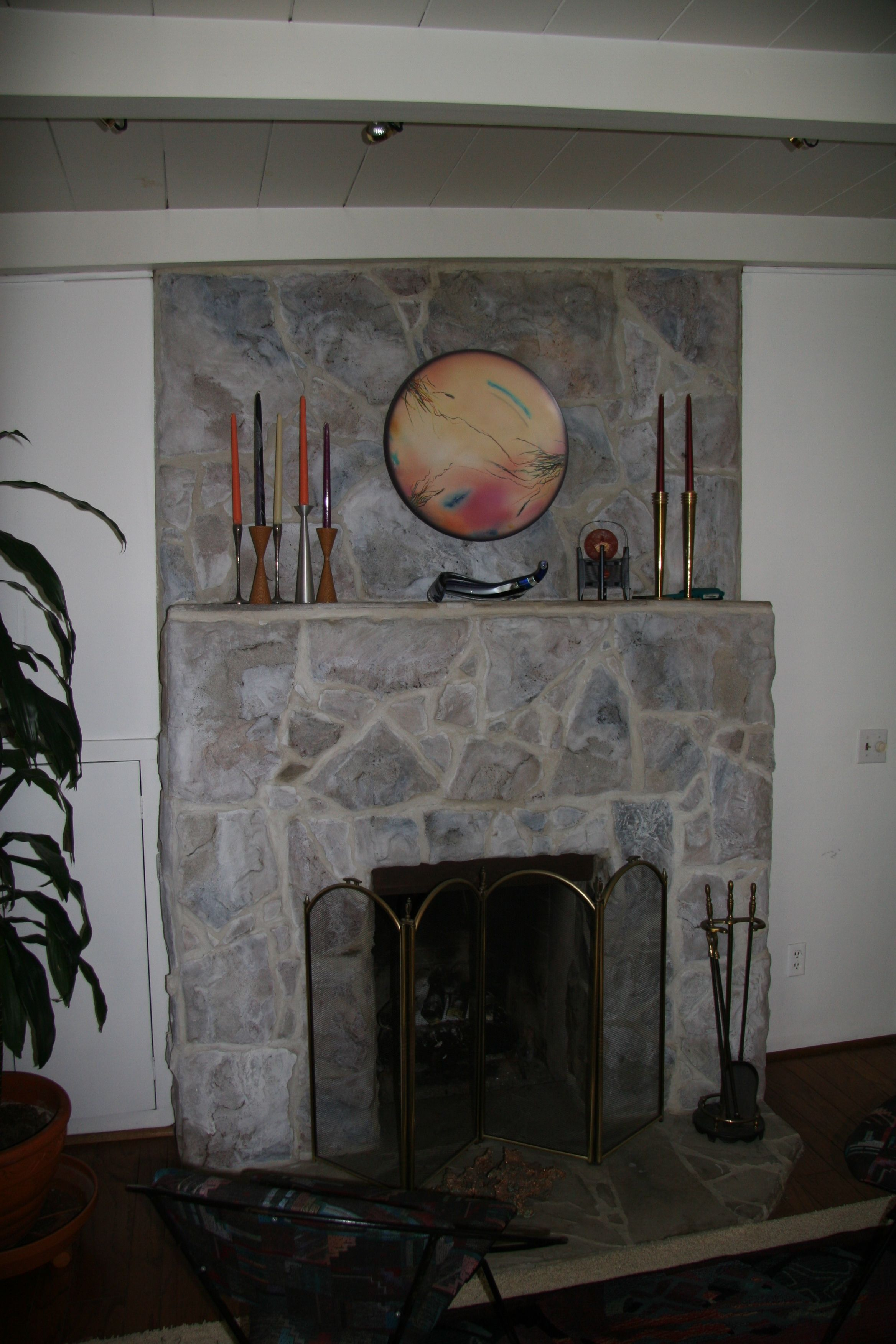 painters and decorators paint an ugly fireplace stone