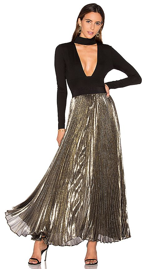 b3e8b45d3 Shop for Alice + Olivia Katz Pleated Maxi Skirt in Gold & Black at REVOLVE.  Free 2-3 day shipping and returns, 30 day price match guarantee.