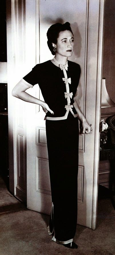 """Wallis's severely plain crepe dress decorated with bows is by Mainbocher."" from The Windsor Style by Suzy Menkes"