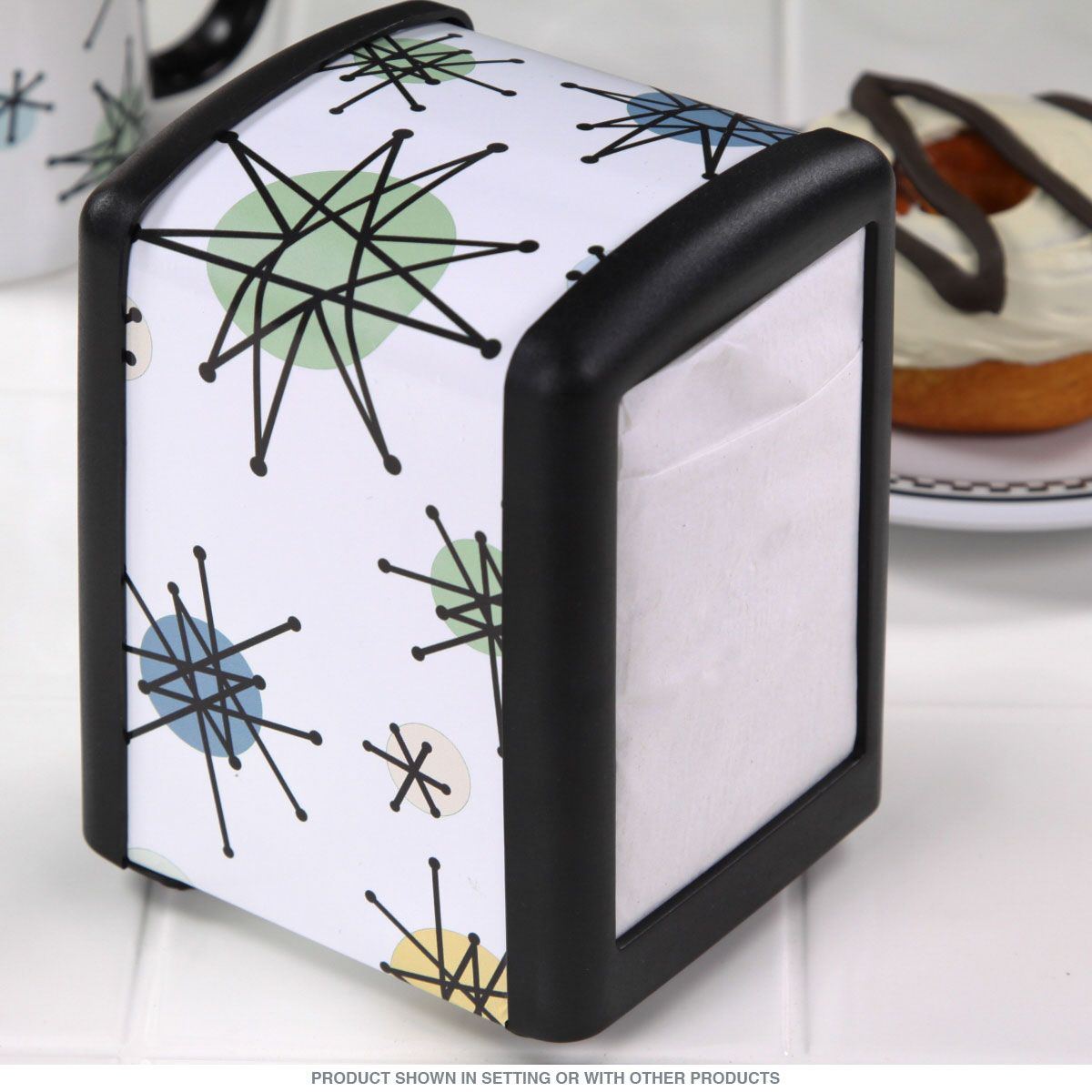 Retro diner napkin holder for half size restaurant napkins. Glossy vinyl decal with vintage Franciscan sputnik design makes it the perfect napkin dispenser for a 50s style diner, lunch room or dining room. Made of metal and plastic. Napkins not included. Measures 4.75