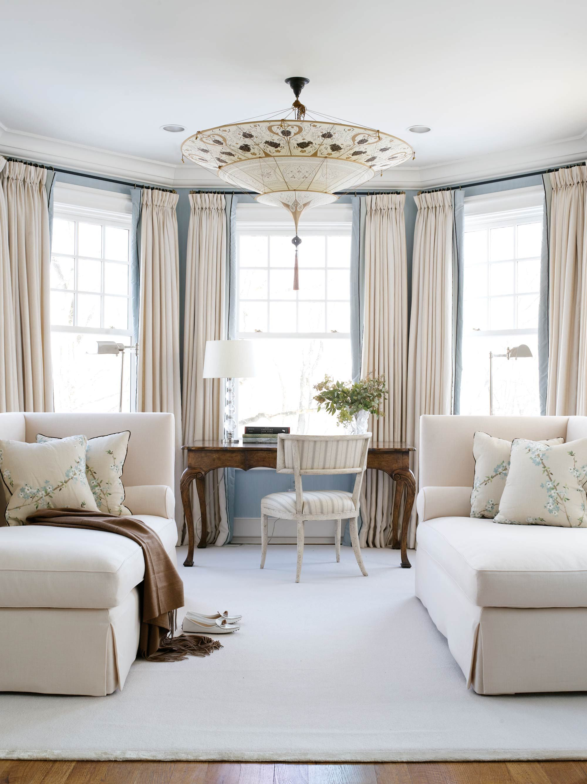 Master Bedroom With Sitting Area with its pale blue walls and plush cream wool chaises, lovely