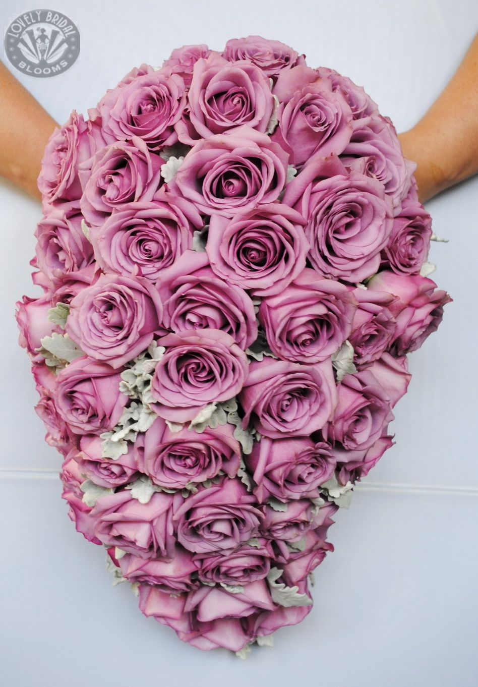 premium trailing bouquet of cool water mauve roses and silver foliage