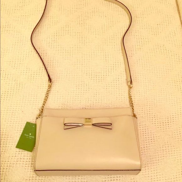 Kate Spade handbag Beige coloring great casual or formal bag. Slight scuff on inside of strap kate spade Bags Crossbody Bags