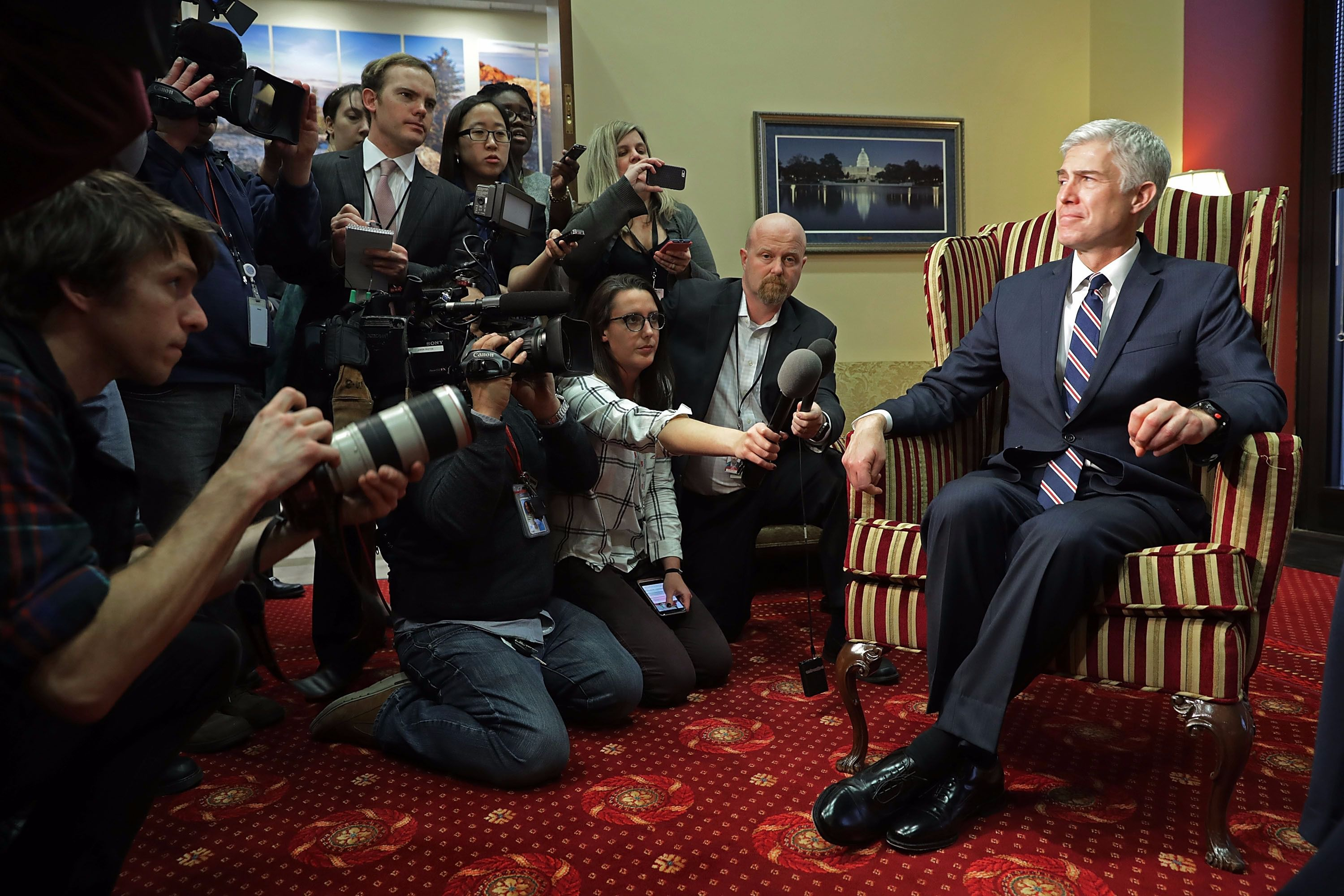 Neil Gorsuch gets comfortable.