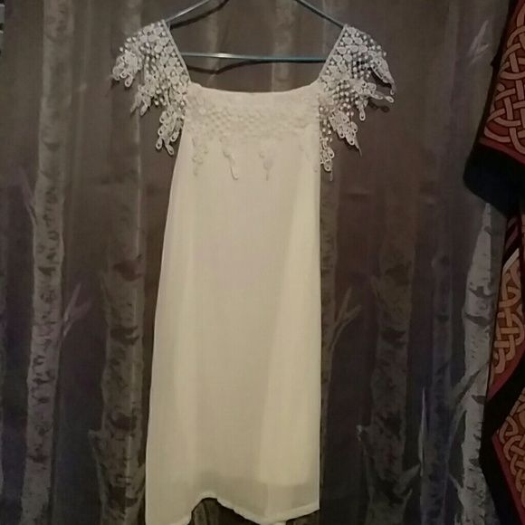 White top with lace arm detailing and belt Size M but fits like a S. Can also be a cute beach cover Tops Blouses