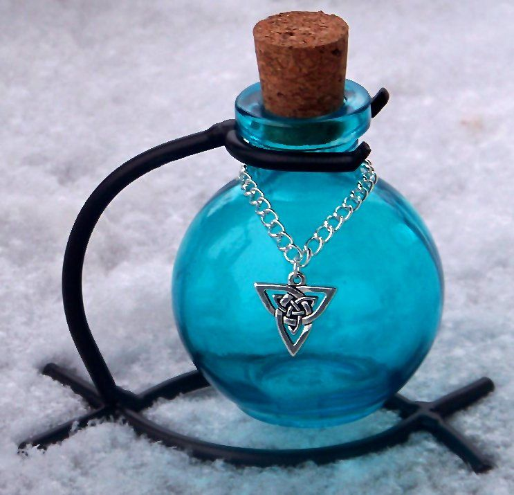 PRIESTESS OF AVALON Blue Aqua Turquoise Triquetra Magic Potion Bottle, Enchanting Corked Glass Vessel with Sturdy Metal Stand.