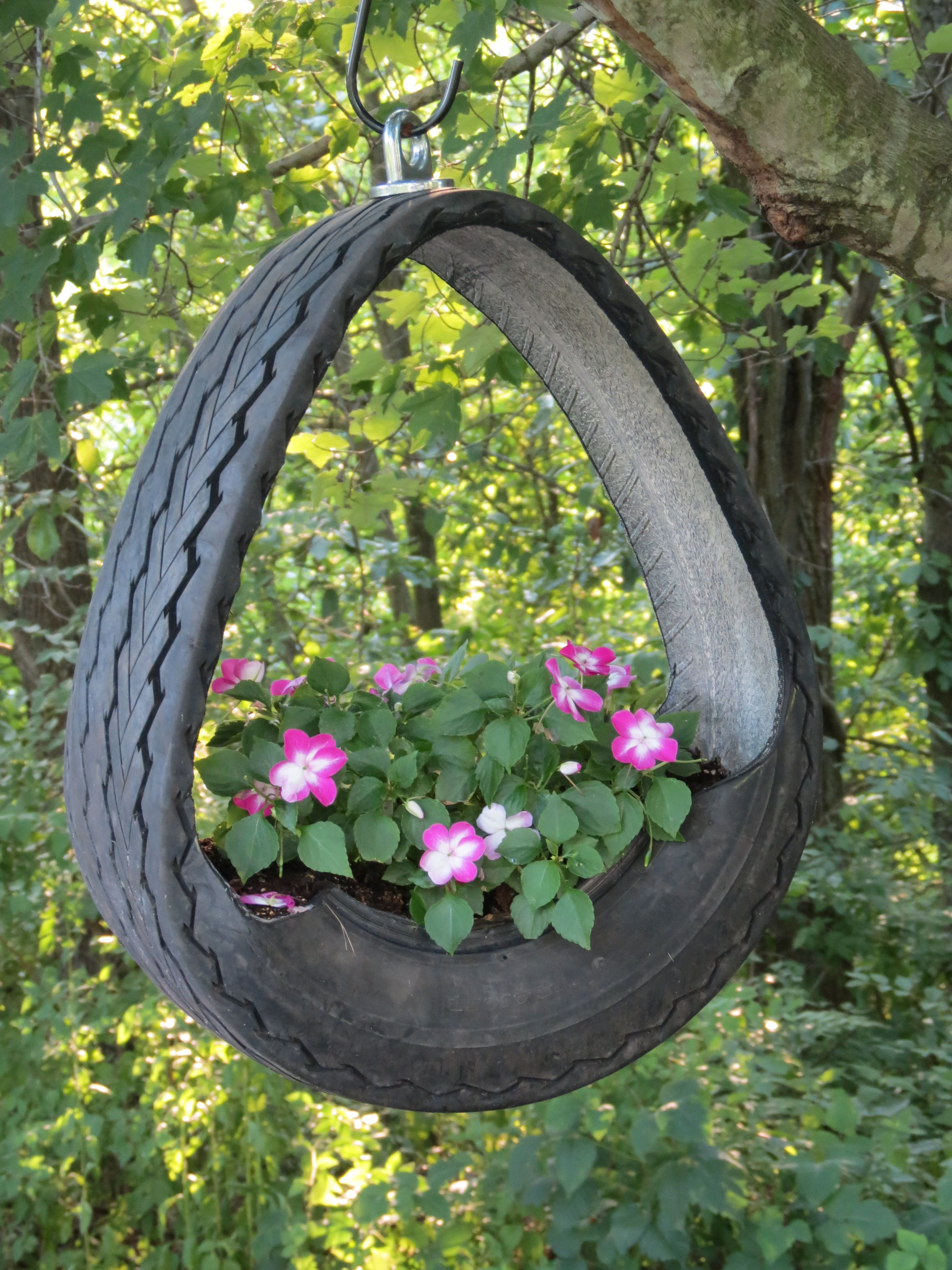 hanging planter made from tire tires pinterest. Black Bedroom Furniture Sets. Home Design Ideas