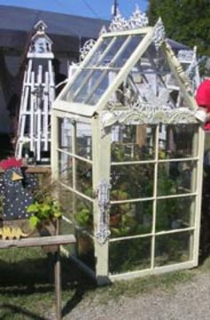 old windows ~ mini greenhouse would look sweet in garden or in yard