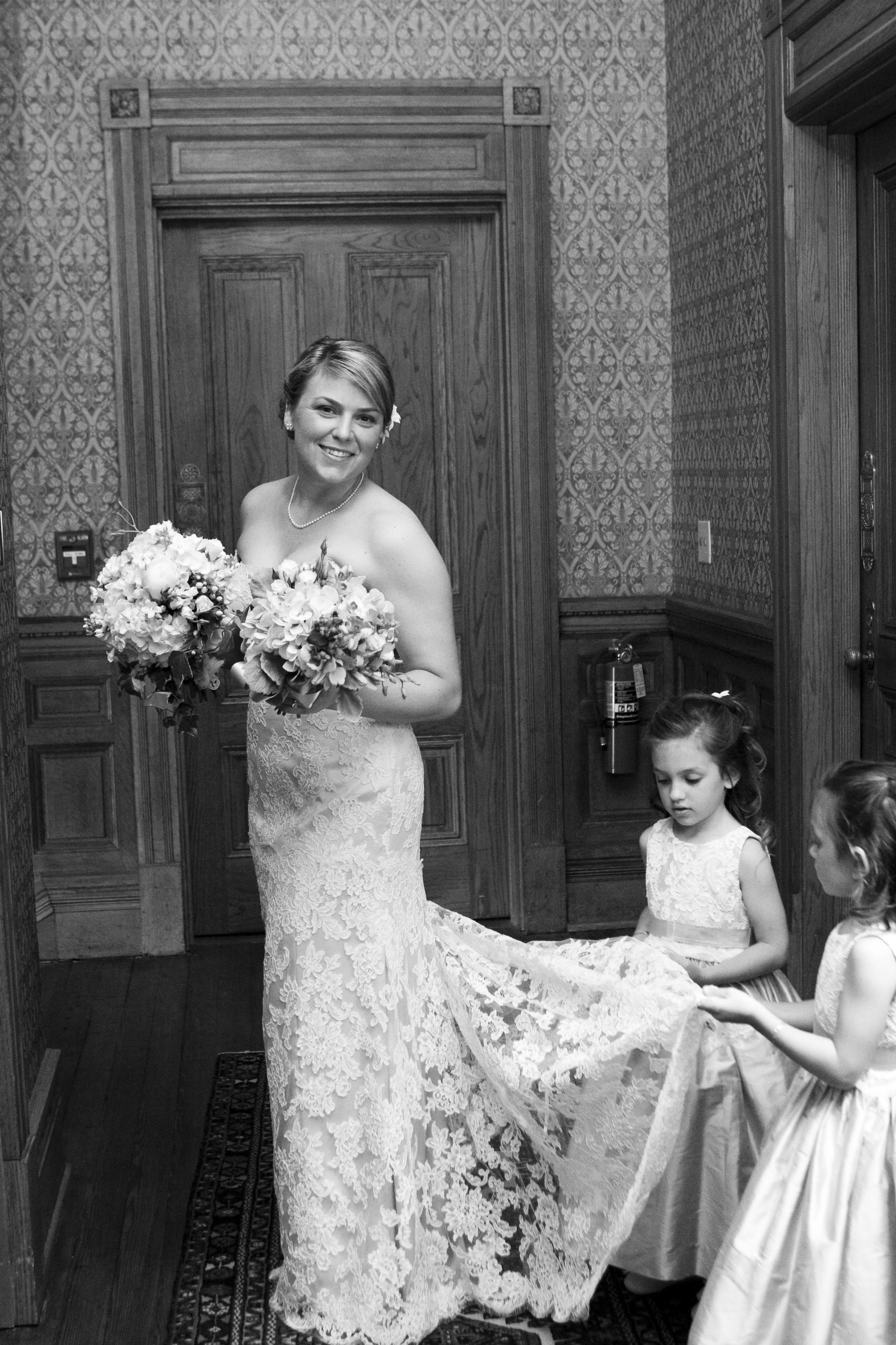 Flower girls helping the bride with her dress the people pinterest