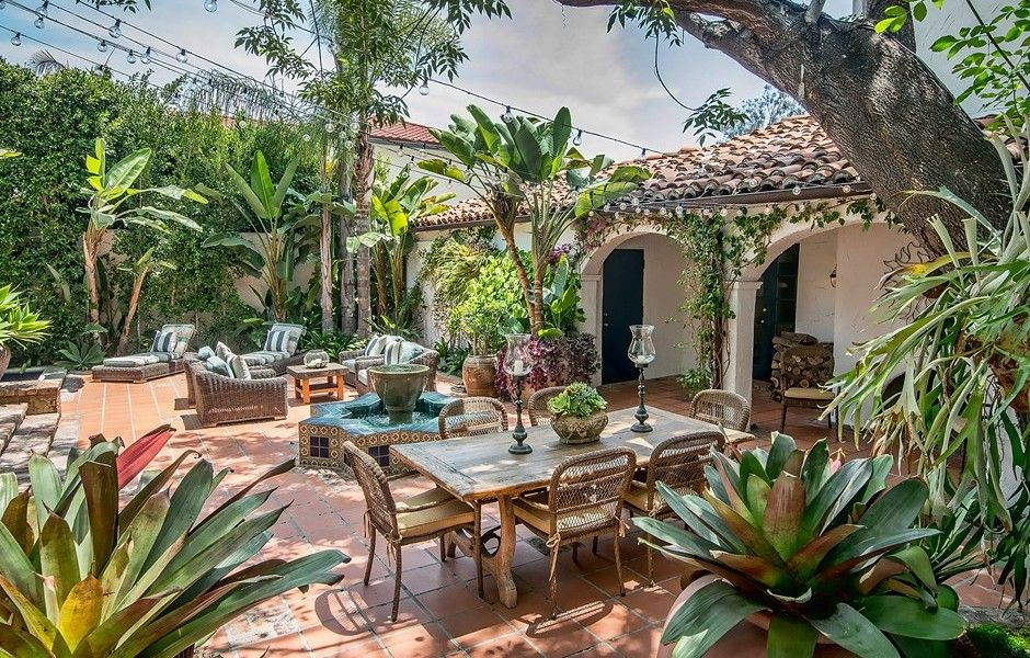Beverly Hills Spanish outdoor living space - incredible