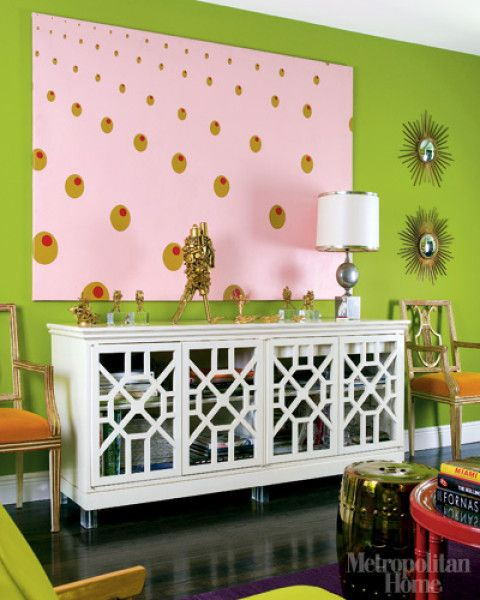 The hot-tropical living room of Nisi Berryman\'s home is filled with ...