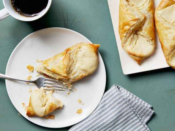 Easy Cheese Danish : Ina's morning treats are filled with ricotta and cream cheese, brightened up with a whole tablespoon of lemon zest and made easier by at-the-ready frozen puff pastry.