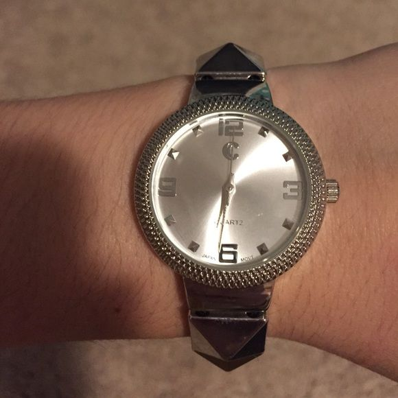 Silver studded watch Stretchy, great condition no scratches and does not need a new battery Charming Charlie Accessories Watches