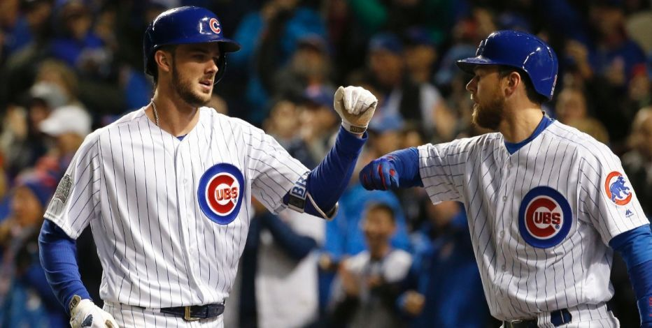 Chicago Cubs' Kris Bryant, left, celebrates with Ben Zobrist after hitting a home run during the fourth inning of Game 5 of the Major League Baseball World Series against the Cleveland Indians, Sunday, Oct. 30, 2016, in Chicago. (AP Photo/Nam Y. Huh)