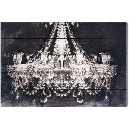 Offering all the opulence of a real chandelier, this elegant planked-wood wall decor adds a sense of drama to your master suite or parlor.