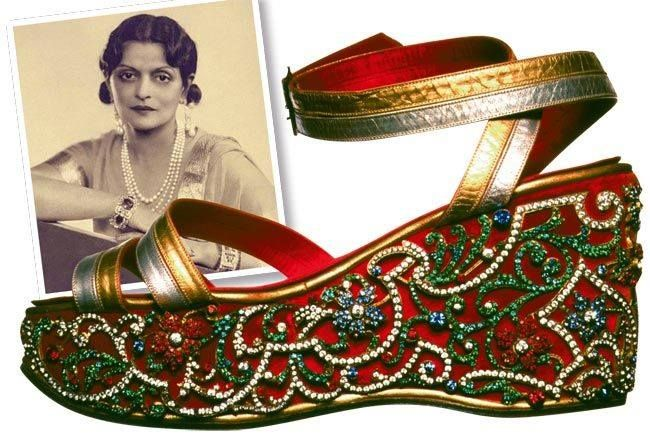 From the 1940's. Beaded wedge sandals.. Indira Devi, The Maharani of Cooch Behar , West Bengal, commissioned Salvatore Ferragamo to create this shoe. It's made from gold and silver dyed kid, with a satin lining.The velvet cork wedge, was studded with diamonds and other precious gems, sent over by the Maharani, from India.