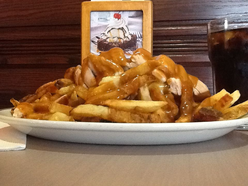 Swiss Chalet Chicken Poutine excellent with their signature Chalet sauce.