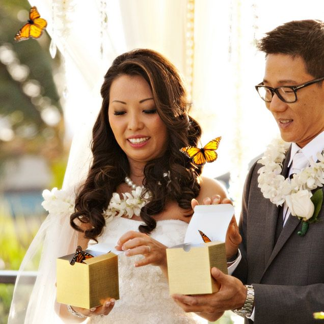 to seal their nuptials the newlyweds release butterflies