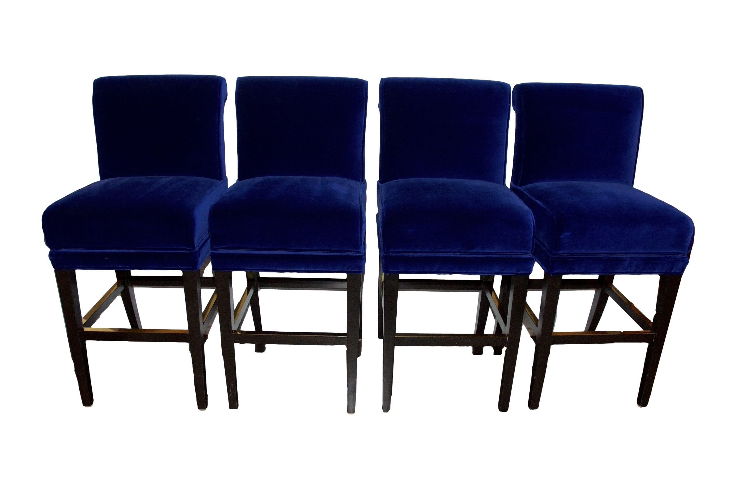 Set of four dark blue velvet bar stools with metal foot rest within