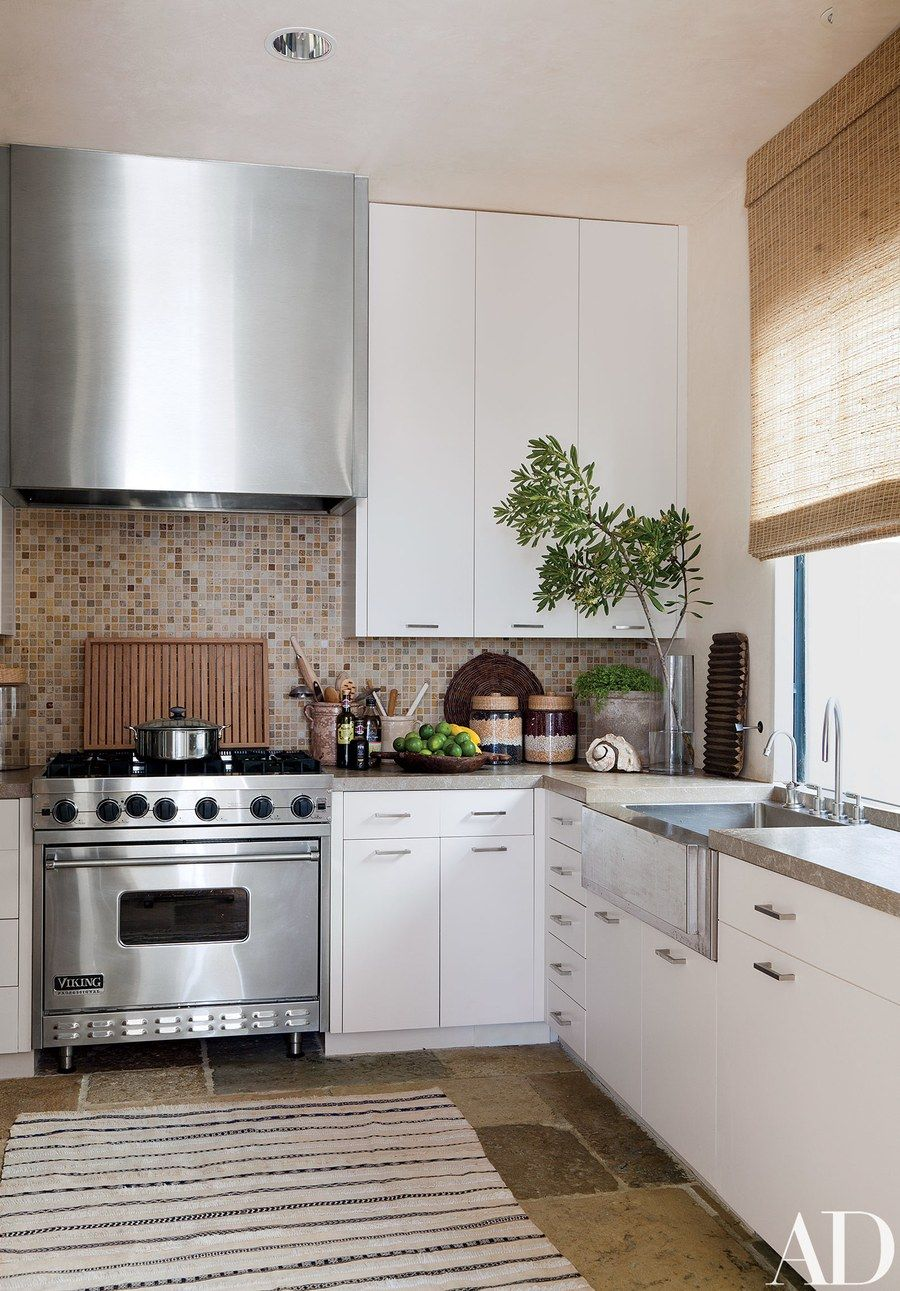 The kitchens mosaic tile backsplash stone counters and limestone the kitchens mosaic tile backsplash stone counters and limestone floor are from exquisite dailygadgetfo Image collections