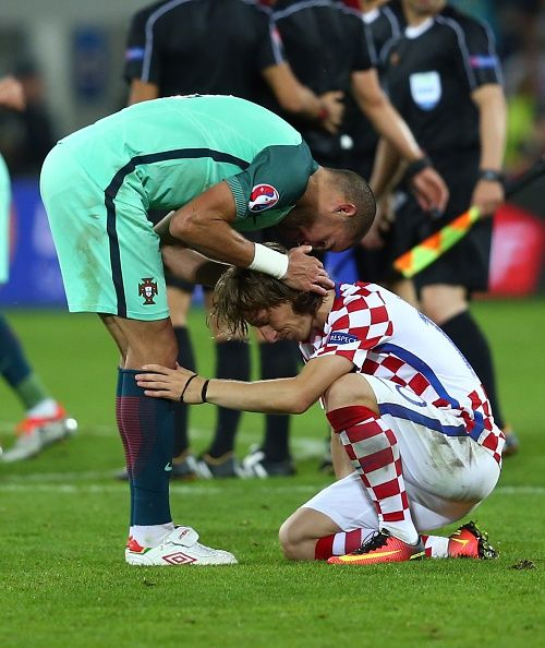 #EURO2016 Pepe of Portugal comforts Luka Modric of Croatia after the Euro 2016 round of 16 football match between Croatia and Portugal at Stade BollaertDelelis...