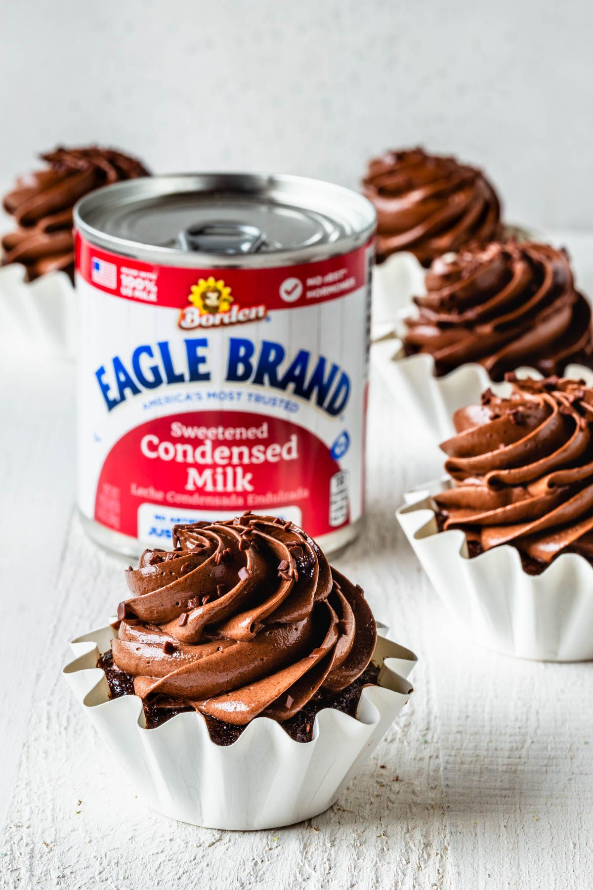 Chocolate Cupcakes With Sweetened Condensed Milk Frosting Recipe In 2020 Sweetened Condensed Milk Recipes Milk Recipes Sweet Snacks