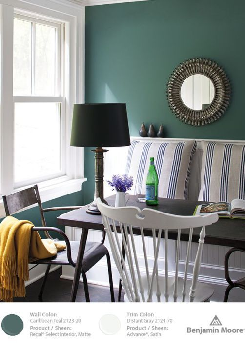 the accent wall paint color is benjamin moore mayo teal cw 570