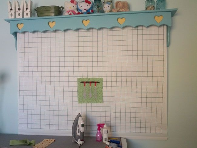 Homemade roll up design wall placed under a shelf like valance for ...
