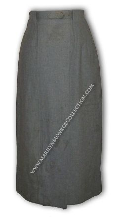 """A gray wool skirt from the personal wardrobe of Marilyn. A-line in cut with a matching belt, the interior label reads: """"Matthews / Beverly Hills."""" A signature wardrobe item from the 1950s, Marilyn often wore skirts in private and public settings, and even in her films."""